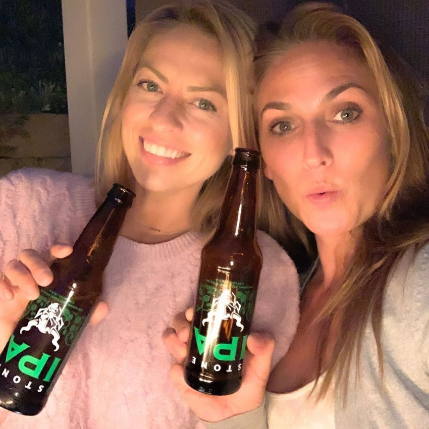 two girls with stone ipa