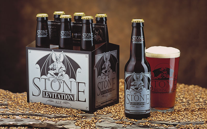 Stone levitation ale six-pack and glass