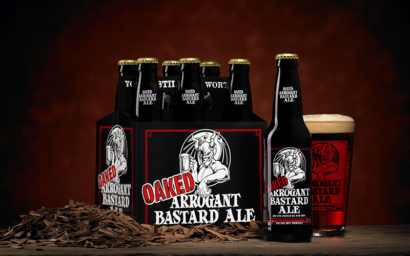 Oaked Arrogant Bastard six-pack and glass