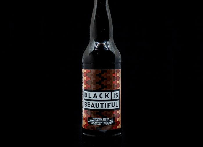 bottle of black is beautiful