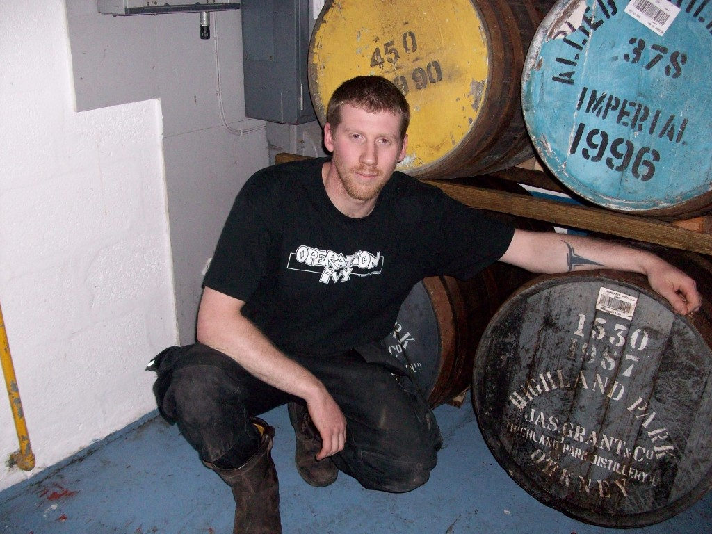 BrewDog's Stewart Bowman cozying up to a lovely cask of bashah maturing with tayberries