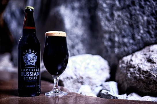 imperial russian stout beer in a glass and bottle