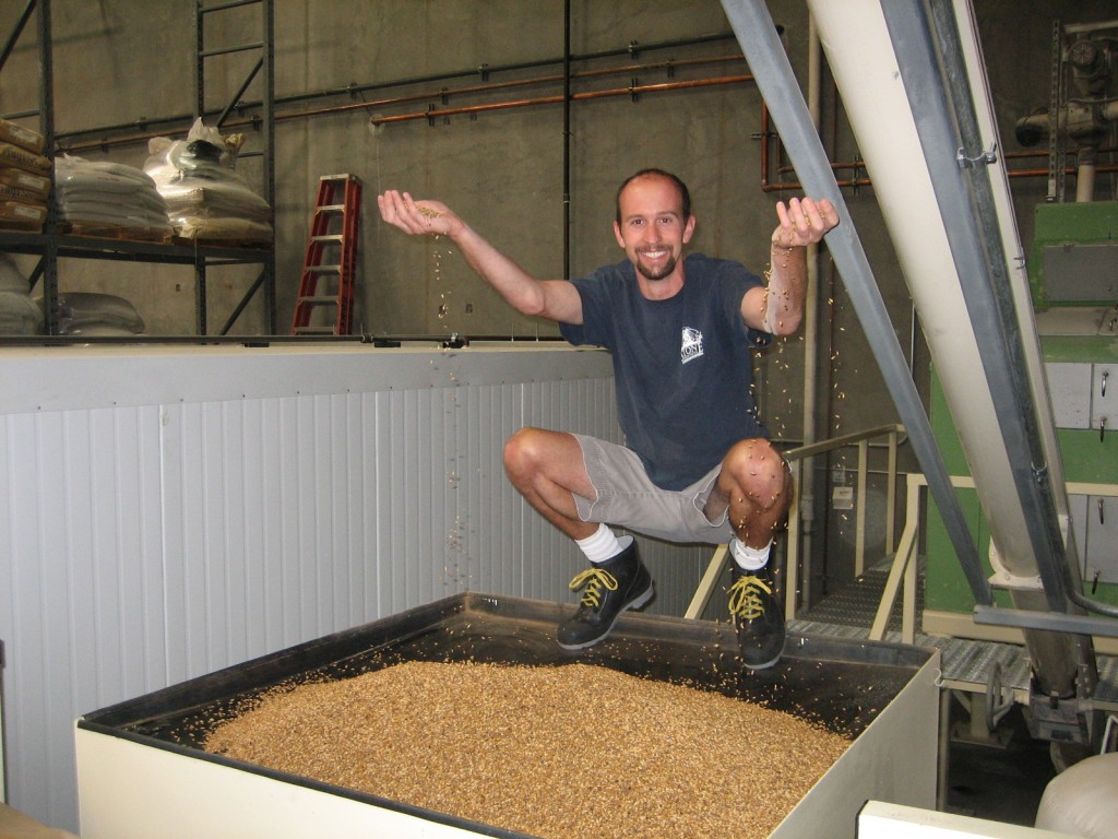 Our Brewhouse Supervisor, Jeremy Moynier, playing with malt