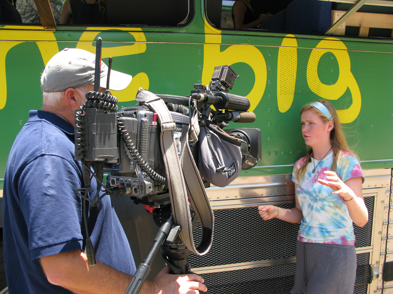 Anna, a Dartmouth sophomore from the Big Green Bus, being interviewed for the local news. The Big Green Bus is greeted by cameras wherever they go.