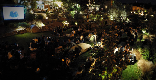 People ready for a movie in the Stone Liberty Station gardens
