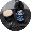 Glass and bottle of Stone Smoked Porter w/Vanilla Bean