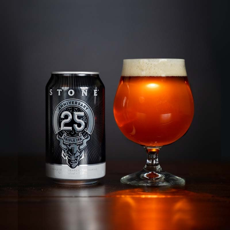 can and glass of Stone 25th anniversary triple IPA