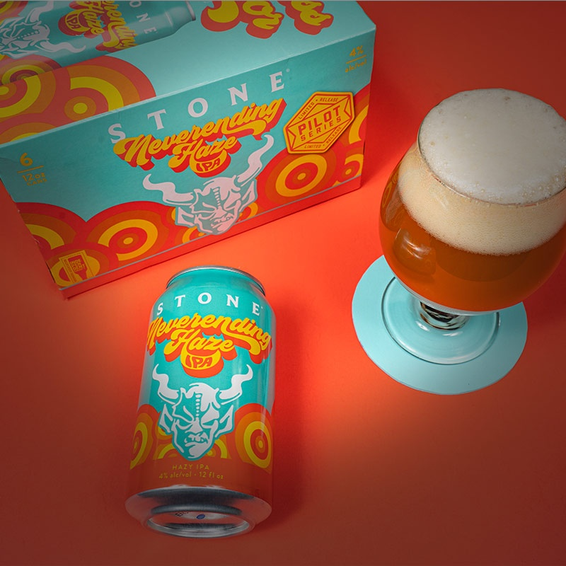 Stone Neverending Haze IPA can, six-pack and glass