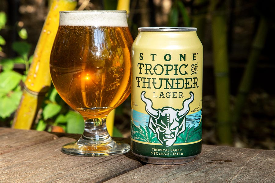 Tropic of Thunder can and glass