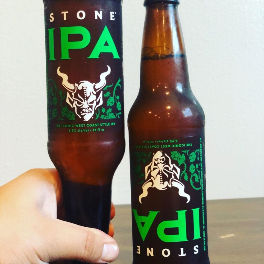 two beer bottles with upside-down labels
